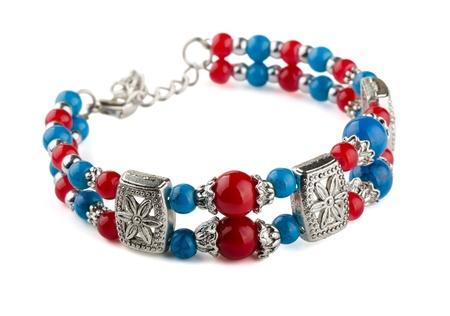 Ethnic bead bracelt isolated on white photo