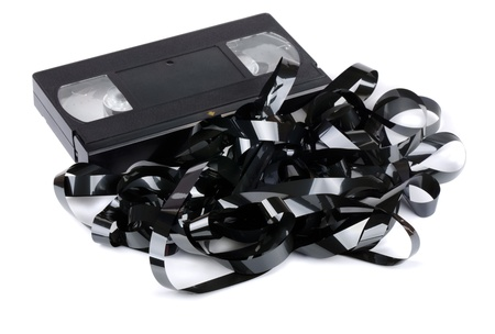 video cassette tape: VHS video cassette with tangled video tape isolated on white Stock Photo