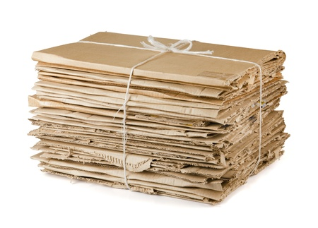 compressed: Waste cardboard bundle for recycling isolated on white Stock Photo