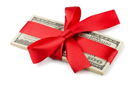 bundles: Bundle of US dollars tied with red ribbon isolated on white