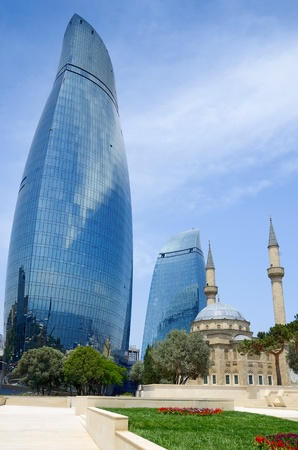 modernity: The Turkish mosque and modern buildings. Baku. Azerbaijan.