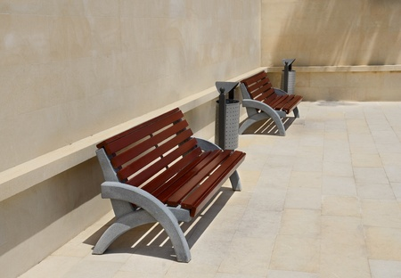 Two empty benches by the wall photo