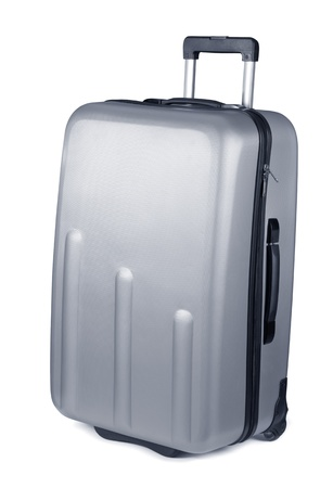 Silver plastic suitcase on wheels isolated on white photo