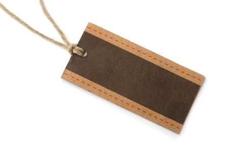 luggage tag: Empty brown paper tag isolated on whiteon white  Stock Photo
