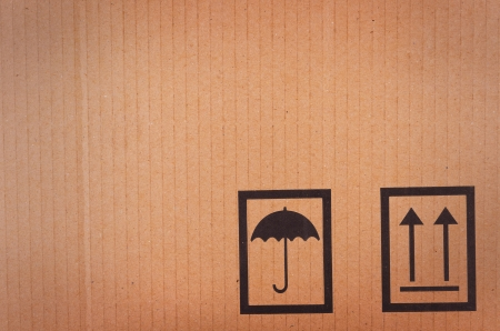 moving boxes: Cardboard background with shipping icons Stock Photo