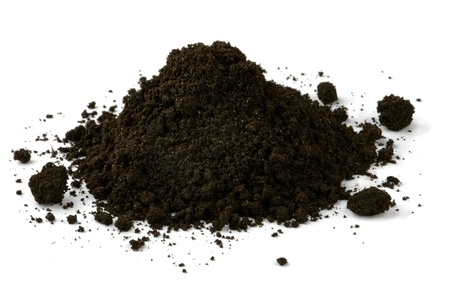Pile of black fertile soil isolated on white photo