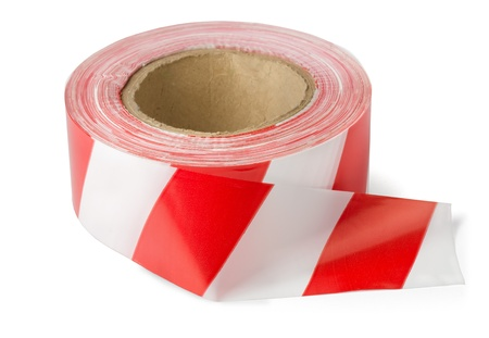 Roll of red white barrier tape isolated on white photo