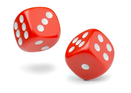 Two rolling red dice isolated on white photo