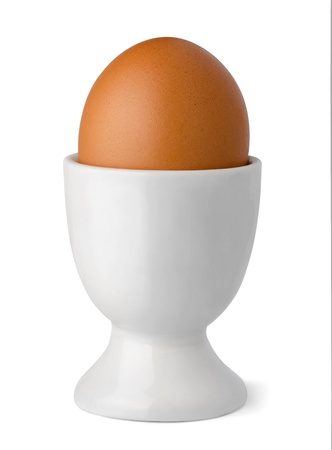 eggcup: Brown egg in egg cup isolated on white Stock Photo
