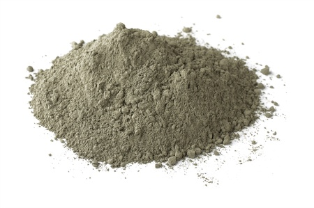 portland: Pile of dry grey portland cement isolated on white