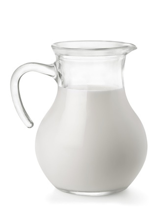 jugs: Glass jug of fresh milk isolated on white