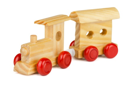 Wooden toy train isolated on white photo