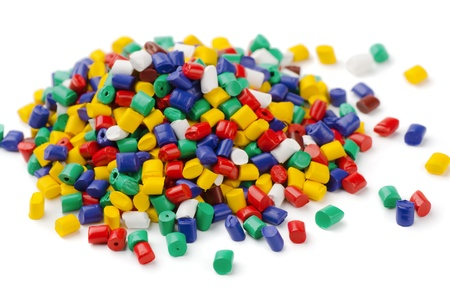 Pile of colorful plastic polymer granules isolated on white photo