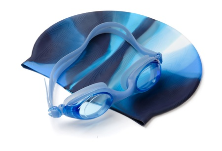Blue swimming cap and goggles isolated on white photo
