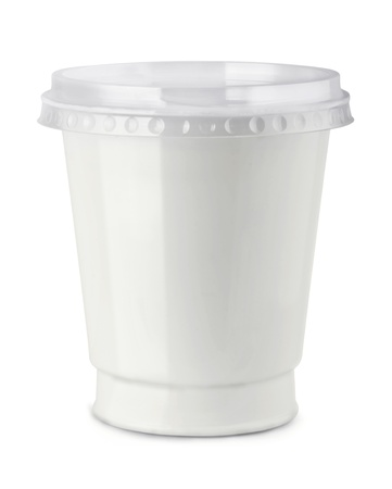 White plastic container of sour cream isolated on white photo