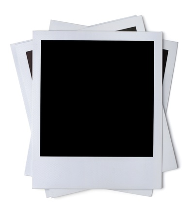 photo studio: Stack of blank paper photo frames isolated on white