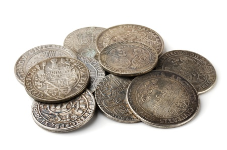 antiquities: Pail of  thalers - ancient european silver coins isolated on white Stock Photo