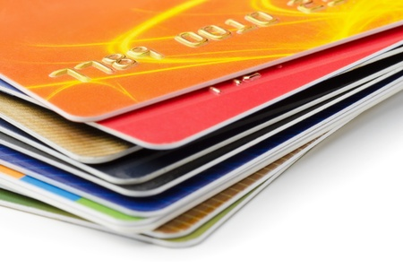 Stack of credit cards on white background photo