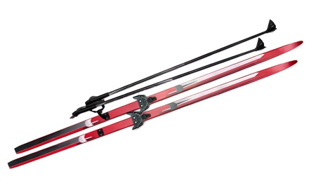 ski track: Cross-country skis and poles isolated on white Stock Photo