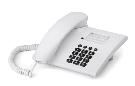 White office desk phone isolated on white photo
