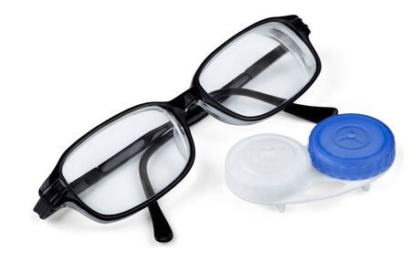 Contact lenses and glasses isolated on white photo