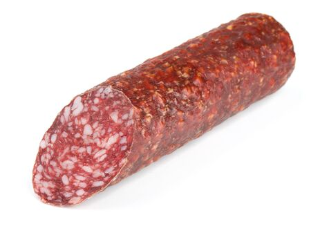 Piece of fresh dry smoked sausage isolated on white