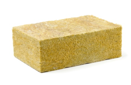 Piece of yellow fiberglass insulation mat isolated on white photo