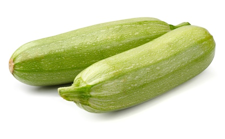 Two fresh zucchini isolated on white photo