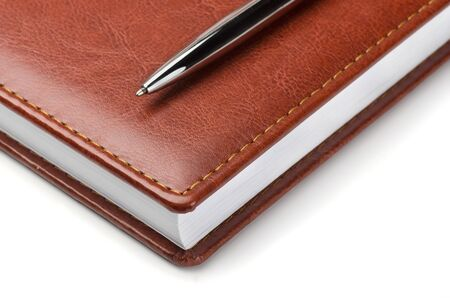 Brown leather notebook with pen on white Stock Photo - 18590791
