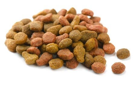 Pile of pet dried food isolated on white photo