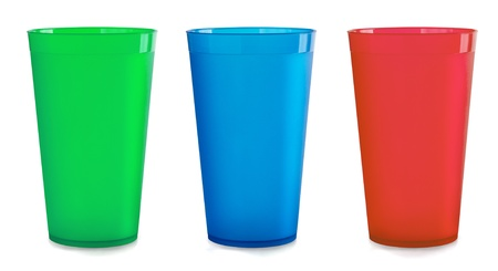 Three colorfull empty plastic cups isolated on white photo