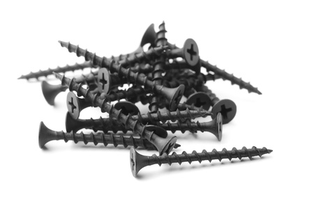 screw heads: Black drywall screws isolated on white
