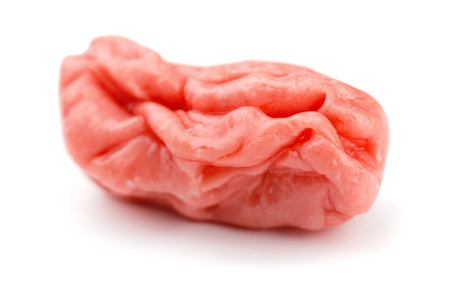 Piece of pink chewed bubble gum isolated on white Stock Photo