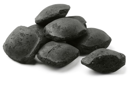 coal fire: Coco charcoal briquetts isolated on white Stock Photo