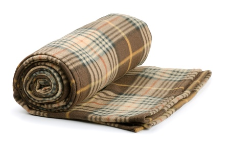 Rolled plaid wool blanket isolated on white