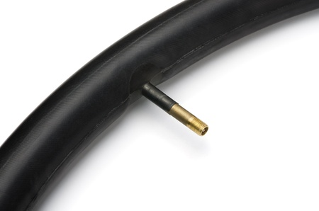 Close up of icycle inner tube with valve photo