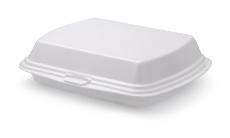 Closed styrofoam food box isolated on white photo