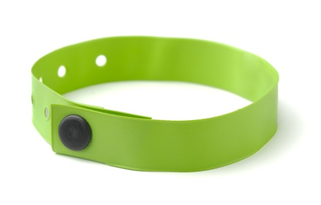 wristband: Green plastic ID wristband for hotel or hospital isolated on white