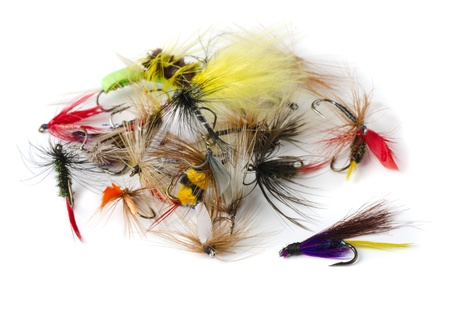 Various fly fishing lures - nymphs, dry flies and streamers isolated on white photo