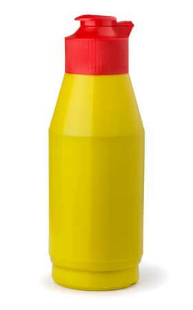 Yellow plastic mustard bottle isolated on white photo
