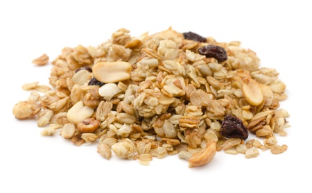 cereal: Pile of granola cereal with raisins and nuts isolated on white