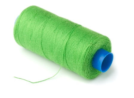 Green thread spool isolated on white Stock Photo - 21961050