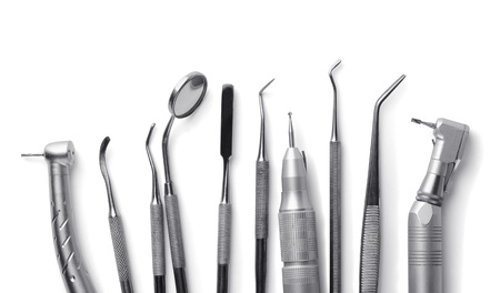 dental medicine: Row of various dental tools isolated on white