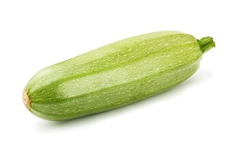 Single fresh zucchini isolated on white photo