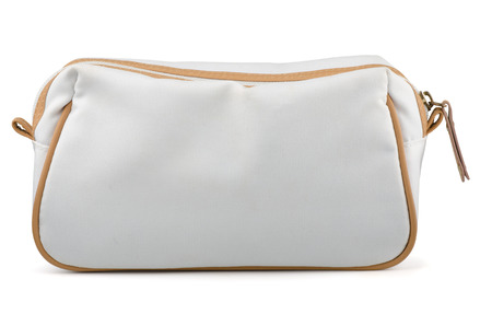 closeup on bags: White textile cosmetic bag isolated on white