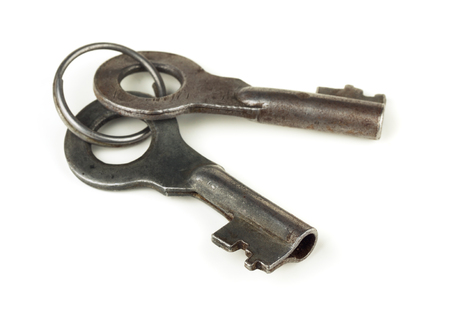 Two old  keys in key ring isolated on white photo