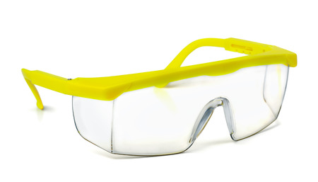 personal protective equipment: Plastic safety goggles isolated on white