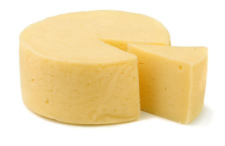 cabra: Rueda del queso tradicional aislado en blanco Foto de archivo