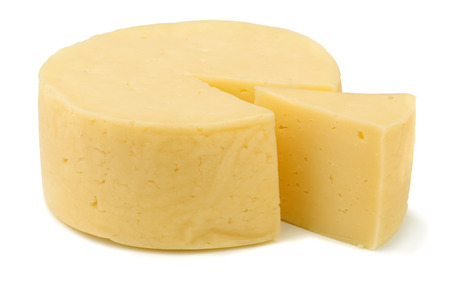 Stuur van de traditionele kaas die op wit Stockfoto