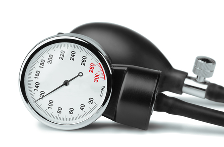 medical supplies: Close up of  sphygmomanometer dial on white background